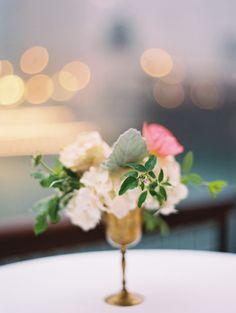 {Garden style spring wedding flowers in brass goblet. Jasmine, poppies, spray roses.} Flowers by Pollen, pollenfloraldesign.com    Photography by Britta Marie Photography, http://brittamariephotography.com.