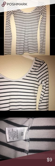 Lightly Loved Striped Long Sleeve! Lightly Loved, NO FLAWS! Adorable Fitting long Sleeve black and white striped Tee.  Worn once-Pairs well with black pants or a black skirt!   Size: XS Material: 62% Polyester, 32% Rayon, 6% Spandex Tops Tees - Long Sleeve