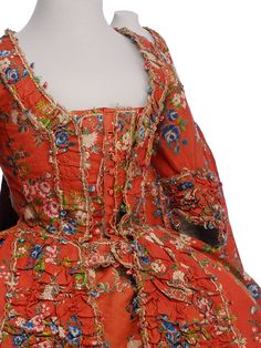 Detail front, robe à la francaise, France, 1760-1770. Coral red silk brocaded with floral motifs in multicoloured silks.