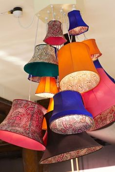 looking for inspiration for my instillation piece. I've been thinking of using my fabrics for lampshades and hanging them in a display. Business Inspiration, Design Inspiration, Lampshade Chandelier, Cluster Lights, Holi, Retail Windows, Prop Design, Visual Display, Blue Rooms