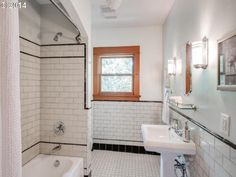 Using white subway tile with black trim in the bathroom