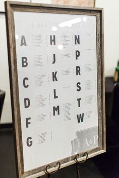 Consider amping up the style of your wedding seating chart while keeping it traditionally basic and functional. Rather than grouping guests by table, this seating chart sign lists them alphabetically. Especially with a long guest list, this helps your friends and family find their seats quickly and easily.  The modern block font of this chart is simple, but also aesthetically-pleasing.