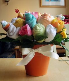 Onsies bouquet- a great alternative to a diaper cake! - decorating-by-day