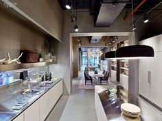 A Taste of Italy: Arclinea's New York Flagship | Door choices for cabinetry include Nordic oak veneer
