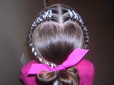Heart hairstyle with ribbons and braids.  Cute for Valentine's Day.