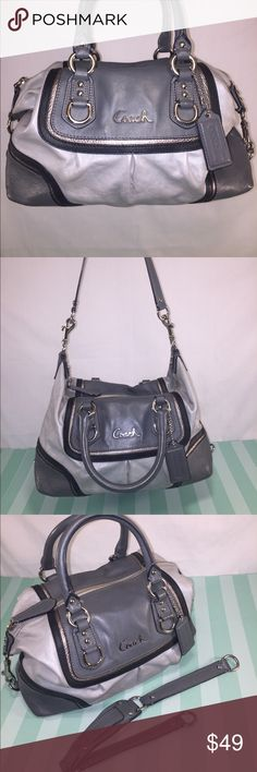 COACH Ashley Spectator-Vintage Satchel/Duffel COACH Ashley Spectator- Vintage Gray & Silver Leather Satchel with silver tone hardware. Pink interior lining shows HEAVY wear (ink & makeup stains), w/1 zip pocket &1 slip pocket. Serial number E1294 – F17455. Removable top strap. Coach tag included. When shoulder piece is removed, sides clip together to make an adorable duffel style bag. Overall zip closure, &gorgeous Coach style. Other than interior & photographed damaged spot on handle, great…