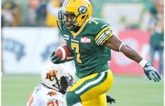 Edmonton Eskimos running back Hugh Charles avoids a tackle from B.C. Lions Dante Marsh at Commonwealth Stadium on Sept. 22, 2012