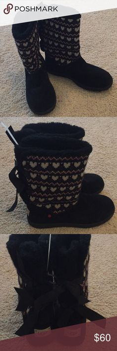 New Big Kids UGG Boots Black W/Hearts & Bows Sz 6 Brand new (no box) first quality UGG boots. Size 6 (Big Kids).   Features:  - Round toe  - Pull-on  - Contrasting sweater knit and suede construction  - Double back bow details  - Inside hidden pocket to store money  - UGGPure wool lined  Materials  Suede/textile upper, UGGPure wool lining, manmade sole UGG Shoes Boots