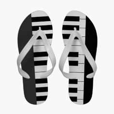 Black White Piano Keys Keyboard Music Flip Flops. Sandals for music fans or musicians featuring the black and white keys of a piano keyboard that span the left and right sandal, against a black background.