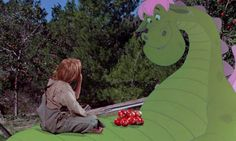 Pete (Sean Marshall) and his best friend Elliott the dragon share some apples.