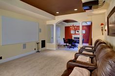 Traditional Home Theater with Carpet, Wall sconce, High ceiling