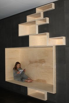 chic nook...... very reclusive yet not suffocating...... transform a boring wall to creative and workable one wow