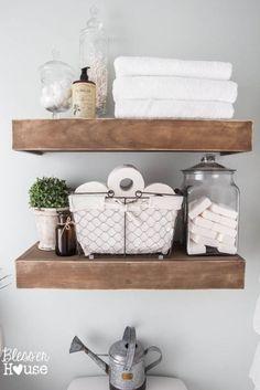 Bathroom open wood shelves, apothecary jars, wire basket, rustic glam bathroom ideas