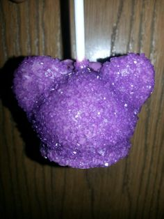 Minnie Mouse cakepop... Purple candy sprinkles on purple candy melt.  Chocolate cake flavor www.facebook.com/roselynnscakepops