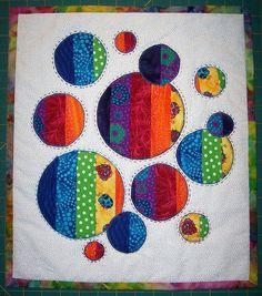 Rainbow - strip piece, then cut circles and applique - hmm. . . .