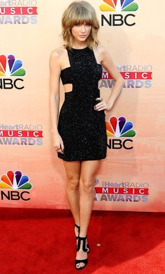 Taylor Swift Flaunts Her Famous Pins In A Mini LBD