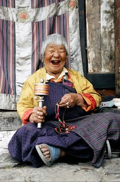 Bhutan laughing nun Happy Non-Mother's Day.