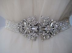 Google Image Result for http://static.schmidtstudioandgallery.com/wp-content/uploads/2011/03/bling-sparkle-wedding-dress-belt.jpg
