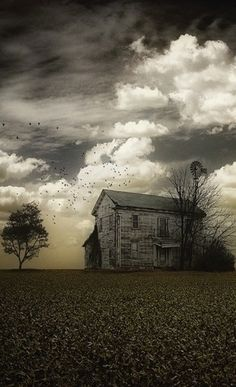 Old Farm House On Cloudy Day