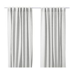 Bleached white curtain panels for living room and bedroom.
