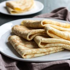 Folded low carb coconut flour crepes on a plate with napkin.