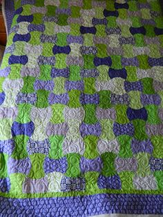 Green and Purple Apple Core Quilt.  Great color combination in this quilt.  Peace, Robert from nancysfabrics.com