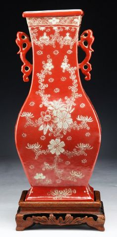 "Fine Chinese Antique Famille Rose Porcelain Vase: angled flaring sides with flat backed form, the neck with dragon shaped handles, presented on a wood stand, of Qing Dynasty; Size: H: 12""; (overall) H: 13-1/2"""