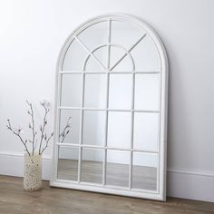 This impressive large window mirror is one of the nicest of its kind and will certainly make a stylish addition to your home.Also available in Grey.The lovely design creates the illusion of a beautiful arched window and is a great way of opening up a room and maximising light into your interior. With its elegant lines, it works beautifully leaned against a wall or can be hung directly onto a wall to create a stunning focal point. The frame has been hand-finished in a lovely distressed…