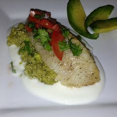 Flounder topped Avocado Quinoa   lemon low fat yogurt cup of quinoa avocado Flounder(or fish of your choice) Cilantro  Tomatoes   1st Layer: squeeze half a lemon and mix with yogurt. Spread a layer  2nd layer: cook quinoa according to package. Cube the avocados. Mix the cooked quinoa and avocado. Place on top of yogurt  3rd layer: pan fry the flounder. (Breading optional). Mix diced tomatoes and cilantro and other half of lemon. Place flounder on top of quinoa and then the cilantro tomato…