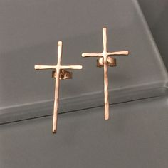 Real 14k yellow gold cross stud earrings. All made with solid 14k yellow gold. HALLMARKED 14K.  Eco friendly recycled gold. NOTE: Available in several thickness.  Ear wire choices is available.  It is made of .91mm (DAINTY), 1mm (GOOD THICK or 1.50mm (VERY GOOD THICK). Dainty earrings but made with extra hard. Please check the last picture for cross length. Hammered marked designs. With secure ear nuts. Beautiful cross earrings. Great jewelry to give it as a gift for yourself or to your…