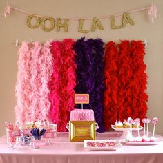 Hosting a princess party? Dress up your dessert table by hanging feather boas and glittery chipboard letters for a gorgeous backdrop (and spot for photo ops!).
