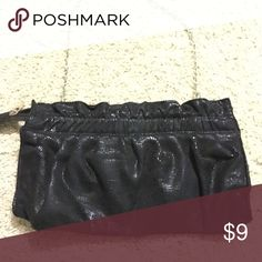 💋3/$13💋Shiny Black Purse Shiny black purse. Has a pattern to it & is shiny when it catches the light. Zipper close. No pockets. Can be used as a small purse or a clutch.❌No Trades ❌No Holds ✅Posh Only ✅ Smoke Free Home ✅Offers Considered ✅Special Bundle Deals (just ask!)💋Part of a 3 for $13 clearance sale. Bundle any 3 items with a 💋, offer $13, & I will accept 💋 Bags Clutches & Wristlets