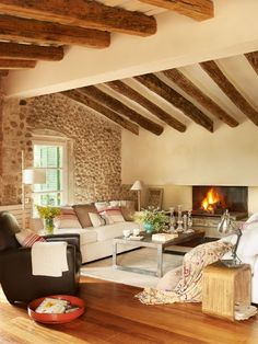 LOVE the room - the beams, the stone - but not fond of the furnishings.
