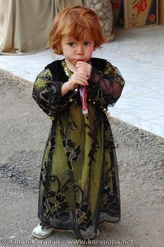 Adorable little Kurdish Girl in her traditional Dress in Kurdistan, Iran.