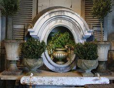 Salvaged window frame and vintage urns!!!