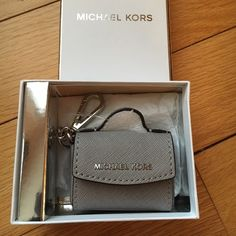 NEW Michael Kors Ava Key Fob NEW Michael Kors Ava Key Fob. This listing is for the Pearl Grey color I have 7 more of these so please ask for new listing so I can discount shipping. . The last 2 pics are of the silver which I have in another listing. Comes with box. no trade no PayPal no holds no lowball offers ✅10% off bundles Michael Kors Accessories Key & Card Holders