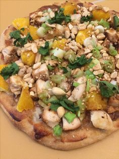 Thai pie: peanut sauce, chicken, orange, peanuts, cilantro, mozz cheese.