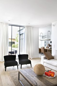 Traditional Meets Modern... Lovely clean space with simple furniture, white and natural fabrics and surfaces