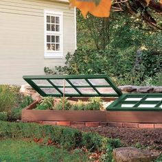 A cold frame built from an old window and scrap lumber. Extend growing season for veggies.