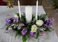 Amazing Unity Candle Arrangement creates the perfect piece for an altar or table and enhances your lighting ceremony! This piece contains White and lavender roses, stock, dusty miller and misty. Stunning! Candle Arrangements, Christmas Arrangements, Candle Centerpieces, Wedding Flower Arrangements, Wedding Centerpieces, Church Wedding Decorations, Altar Decorations, Church Candles, Table Party