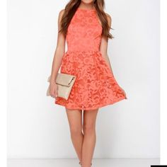 "🌺HP🌺 Coral Orange Lace Dress A halter neckline tops the fitted sleeveless bodice of this cocktail dress, with plenty of patterns dancing in the coral orange lace. Fitted waist introduces a flared skirt, over a darker orange stretch knit lining. Hidden back zipper. Fully lined. Measures approx 33"" from should to hem. Self: 90% Nylon, 10% Spandex. Lining: 100% Polyester. Never been worn. Lulu's Dresses"