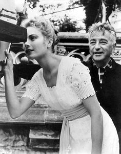 theniftyfifties:  Grace Kelly checks out the composition chosen by director Charles Vidor, on the set of 'The Swan', 1956.