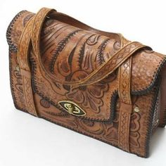 this reminds me of the hand tooled purse my mom used to have... What I wouldn't give to have that bag now... I remember thinking how BEAUTIFUL it was...it makes me smile just thinking about it.
