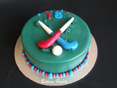 Field Hockey Cake Chocolate with chocolate butter. Covered in rolled fondant and decorated with handmade fondant hockey sticks and ball. Hockey Birthday Cake, Hockey Cupcakes, Dessert Cake Recipes, Desserts, Sports Themed Cakes, Camping Cakes, Dairy Free Treats, Sport Cakes, Brownie Cake