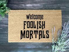 Foolish Mortals Doormat – The Weekend Voyager Disney Doormat, Fall Doormat, Farmhouse Halloween, Coir, Vinyl Crafts, Door Mats, Holiday Decor, Front Porch, Handmade