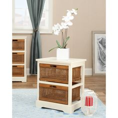 This storage cabinet features two sturdy wood framed drawers with caned sides. White, natural wood highlights this storage cabinet.