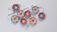 A gorgeous crochet flower garland in light blue, white and pink. The perfect decoration for any girls bedroom!
