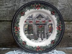 ~ ROYAL STAFFORD ~ CHRISTMAS HOUSE ~ SIDE/LUNCHEON/SALAD PLATE Made in England, Burslem from Royal Staffordshire A beautiful plate, has a grey-wish black border with white dots, pipelines and hollyberries. The center shows the front of the house, snow covered. MEASURES 8 1/2