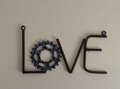 All you need is love - well that's how the song goes! Reminding us that we need love to make the world go round are a few creative artists adorning all sorts of materials in love signage.