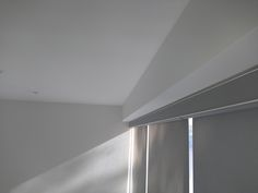 Sunscreen roller blinds with matching pelmet fitted to high level windows using scaffold tower | West London | Living room blinds | Made to measure | Made in UK | Modern blinds